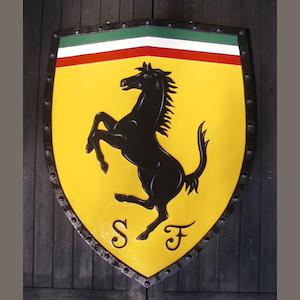 A Ferrari garage display shield,