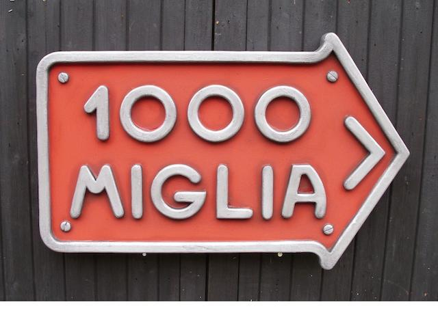 A Mille Miglia garage display sign,