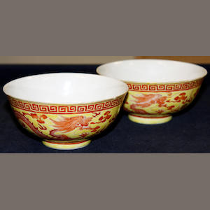 A pair of Chinese iron red yellow ground dragon bowls, 19th Century, bearing Qianlong marks, 13.75cm.