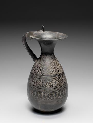 An Etruscan bucchero ware olpe