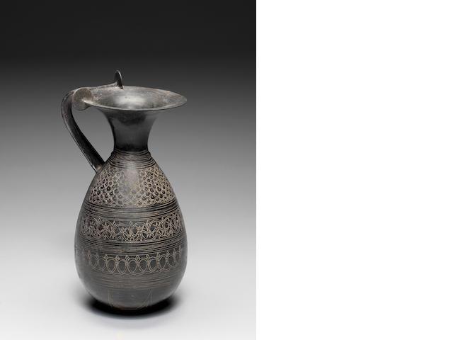 An Etruscan bucchero olpe