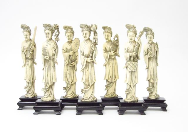A group of seven marine ivory figures Early 20th century