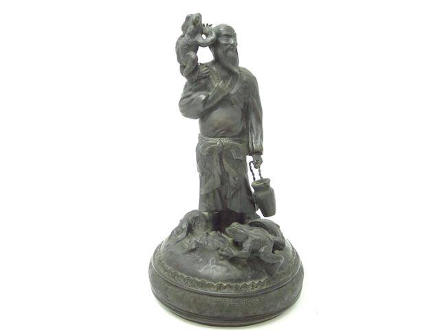 A bronzed cast metal figure of Sennin Circa 1900