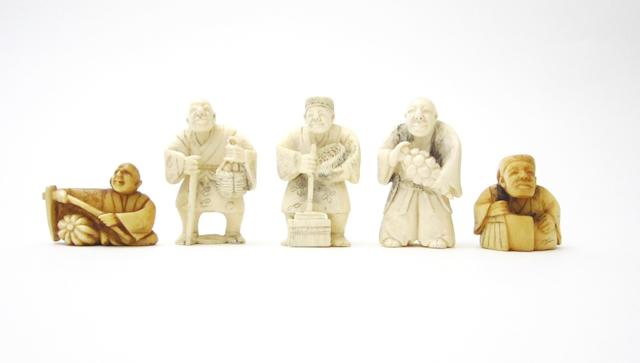 A group of low relief carvings and five netsuke Late 19th century and later