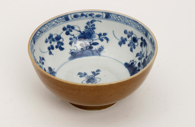 A Chinese blue and white bowl with cafe-au-lait glaze Early 18th Century