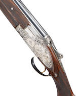 A fine J.M. Martens-engraved 20-bore (2¾in) 'Hunting Windsor Mod. B25' single-trigger side-plated over-and-under ejector gun by Browning, no. 324MM03194 The whole in a Browning Custom Shop leather case