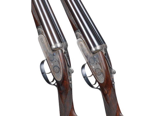 A fine pair of 12-bore self-opening sidelock ejector guns by J. Purdey & Sons, no. 25831/2 In a brass-mounted oak and leather case with later J. Purdey & Sons trade-label and reproduction Charge Sheet