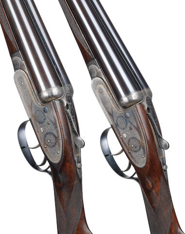 A fine pair of 12-bore self-opening sidelock ejector guns by J. Purdey & Sons, no. 25831/2 In a brass-mounted oak and leather case with later J. Purdey & Sons trade-label