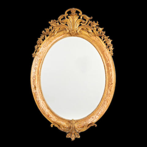 A French late 19th/early 20th century giltwood and composition mirror