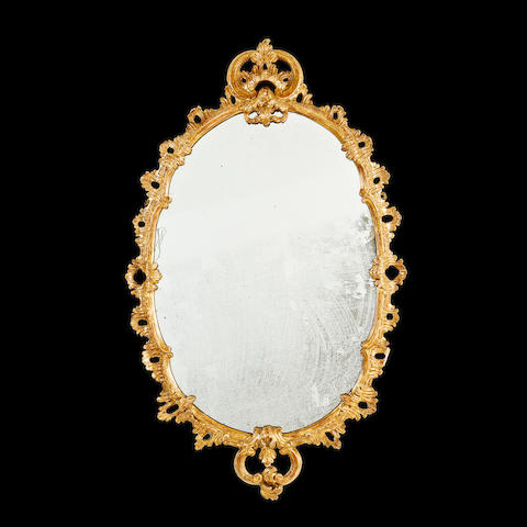 A late 19th century style giltwood mirror in the George III style,