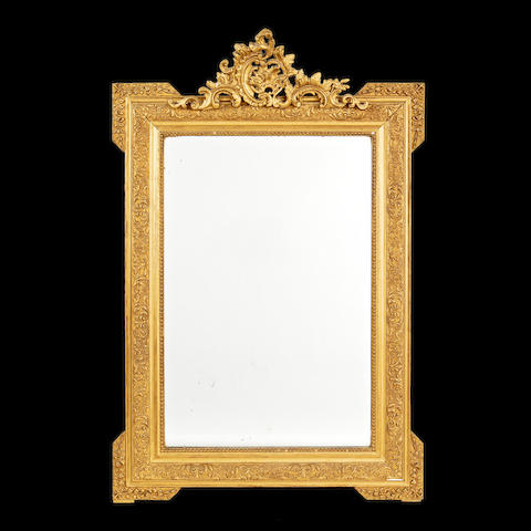 A French early 20th century gilt decorated wood and composition mirror