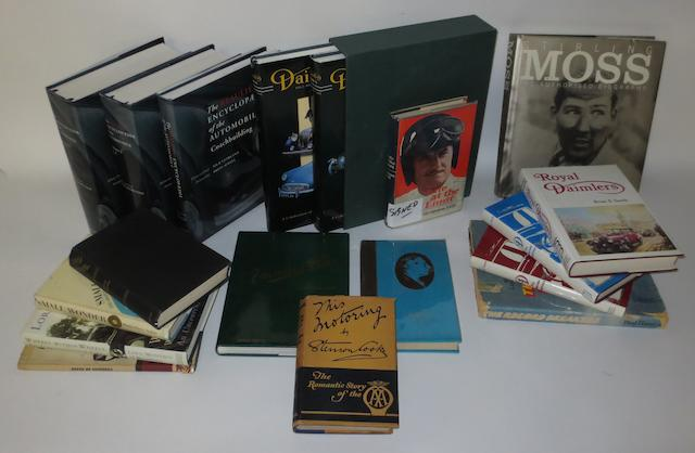 Assorted signed motoring books,