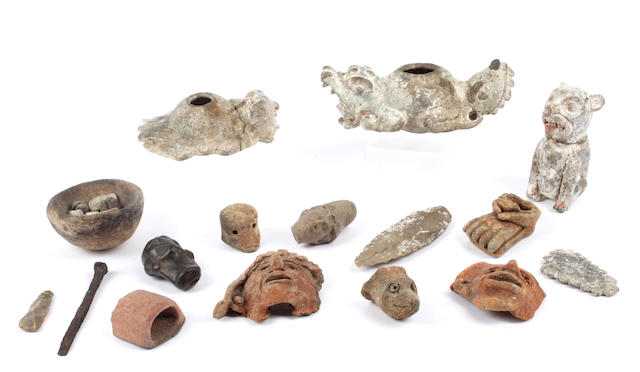 A collection of Pre Columbian Mayan, South American and other antiquities to include 2 pottery faces, a knapped flint spear head and 2 figural lamps and other items. (quantity)