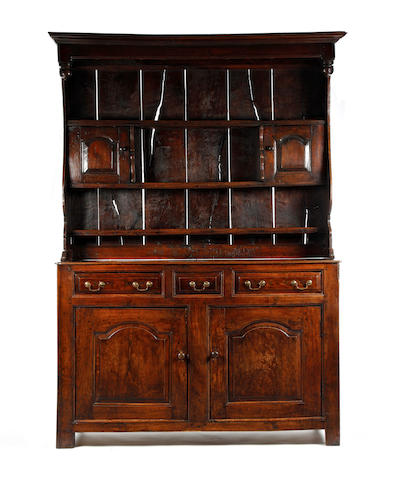A rare George II oak canopy-dresser, Caenarfonshire, circa 1730-50,