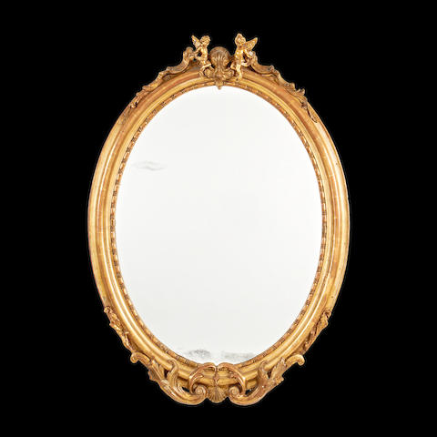 A late 19th/early 20th century giltwood mirror