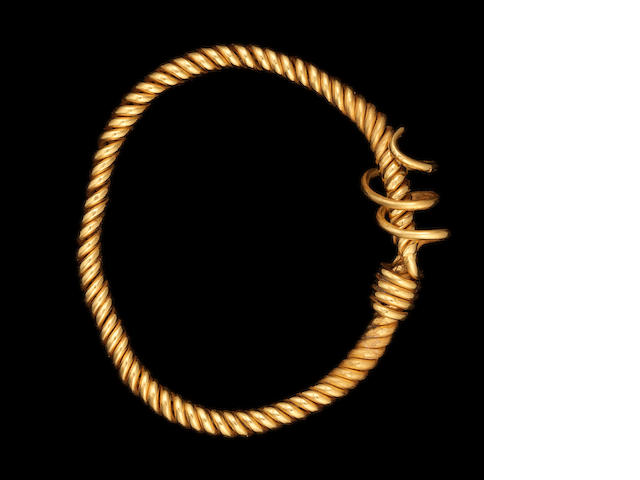 A Romano-Egyptian gold twisted wire bracelet