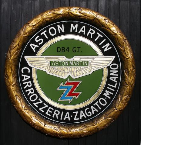 A hand-painted Aston Martin Zagato garage display roundel,