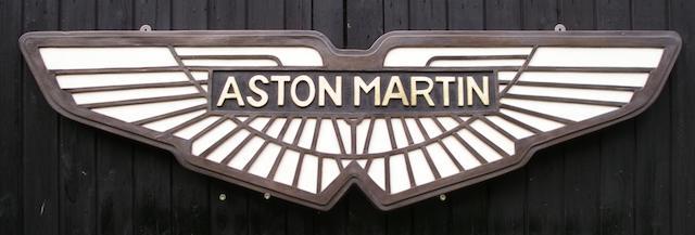 An Aston Martin garage display emblem,