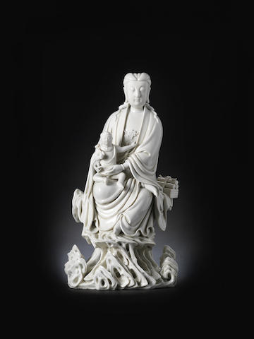 A rare blanc-de-chine figure of Guanyin and child He Chaozong Yin mark and XXXXXXXX mark, 17th century