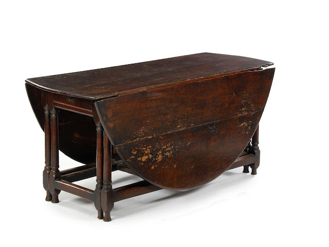A rare large double-action oak gatleg table, circa 1700