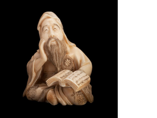 A small ivory figure of monk reading a book By Shizuyuki, Meiji