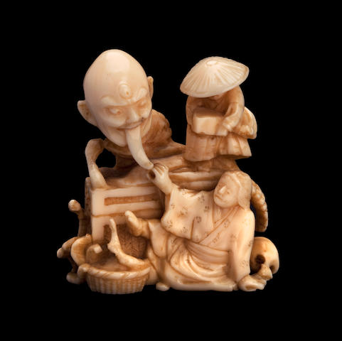 A small ivory group from a ghost story By Fuzuki, Meiji