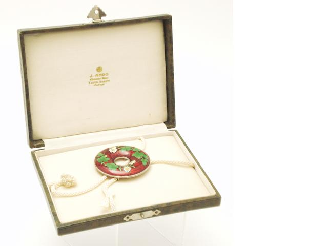 A cloisonné belt buckle In an Ando presentation box