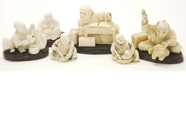 An ivory elephant bridge group and a collection of small figural ivories Meiji/Taisho