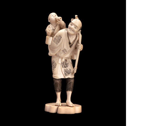 An ivory figure group  By Yoshimasa, Meiji