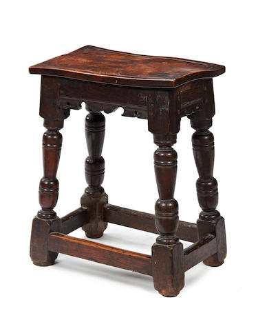 An early 17th century and later elm and oak joint stool English