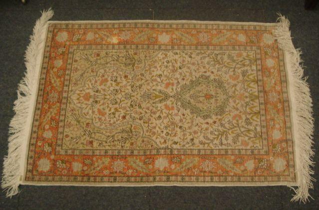 A Kayseri silk rug, 107 x 73cm and fringed.