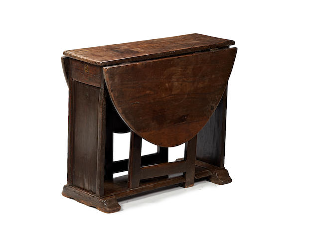 A 17th century oak trestle-end gateleg occasional table