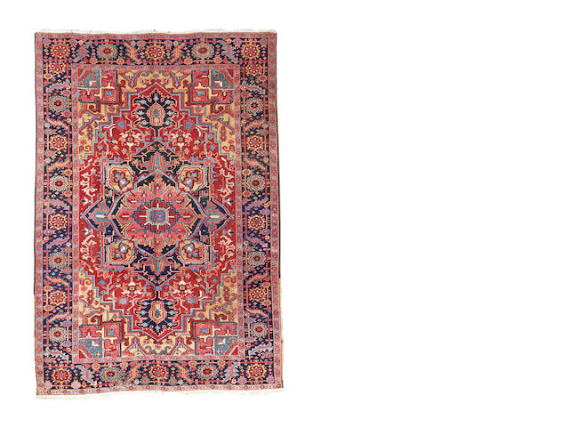 A Heriz carpet, North West Persia, 344cm x 236cm