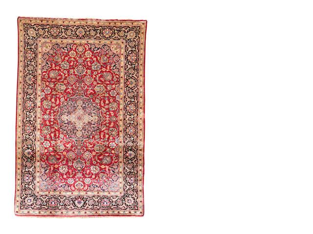 A silk Kashan rug, Central Persia, 203cm x 133cm