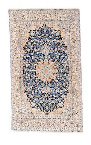 A Tudesh Nain rug, Central Persia, 258cm x 151cm