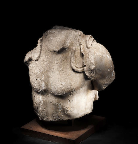 A Roman marble fragmentry torso of Dionysus