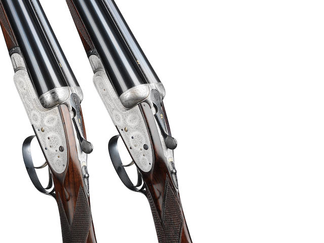 A pair of 12-bore assisted-opening sidelock ejector guns by Boss & Co., no. 5405/6 In their brass-mounted oak and leather case