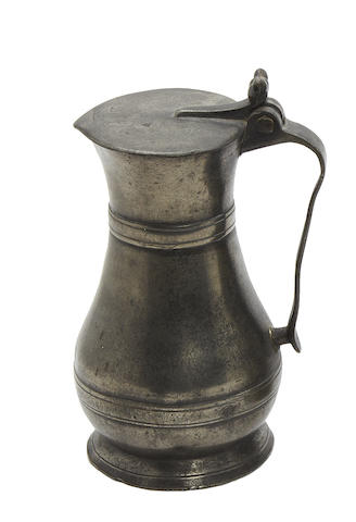 A mid-18th century Guernsey pint lidded pewter measure, circa 1740-50