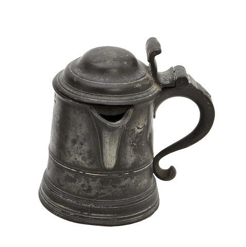 An early 19th century half-pint dome-lidded spouted pewter tankard