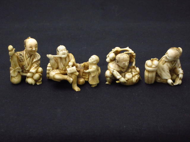 Four small carved marine ivory figures Meiji