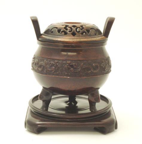 A bronze tripod koro