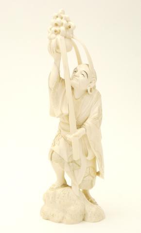 An ivory figural okimono Meiji
