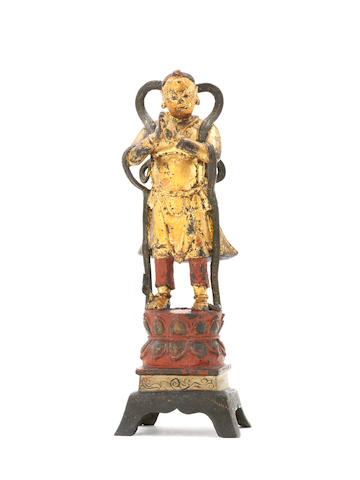 A gold-lacquered bronze figure of a Buddhist figure, Ming Dynasty