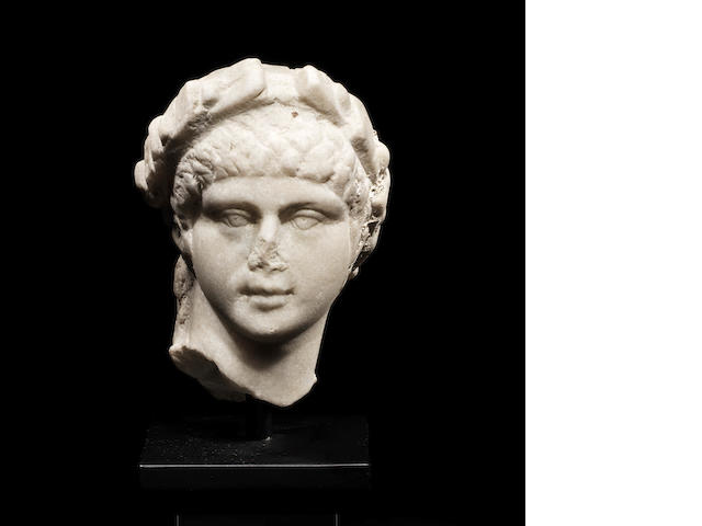 A Roman marble male head wearing a wreath
