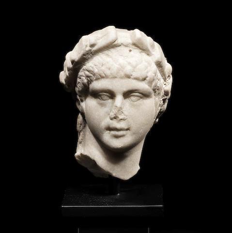 A Roman marble male head wearing a wreath