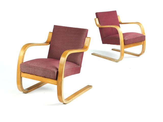 Alvar Aalto for Finmar Ltd A Pair of 34/402 Armchairs designed 1933  applied faded plaques for Finmar Ltd birch faced moulded plywood with fabric upholstery  Height: 72 cm.                28 3/8 in.