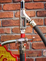 An unusual Bennett model 1500 hand operated petrol pump