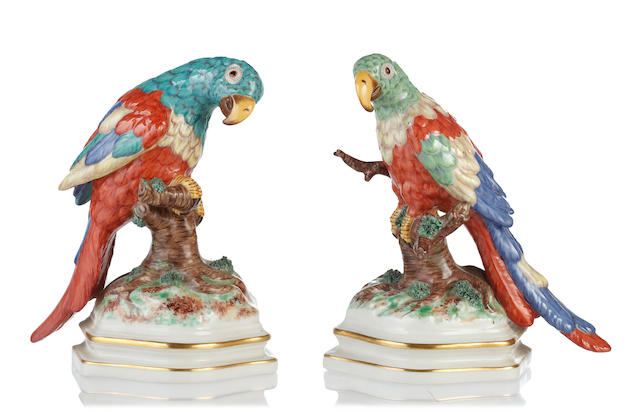 A pair of Nymphenburg models of macaws