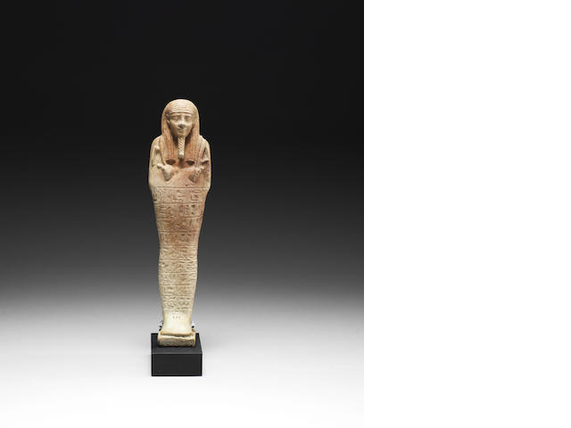An Egyptian shabti of Tja-inher-Imu with a stand