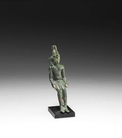 An Egyptian bronze figure of Harpocrates